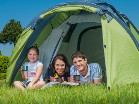 Family enjoying their camping space in Kentucky